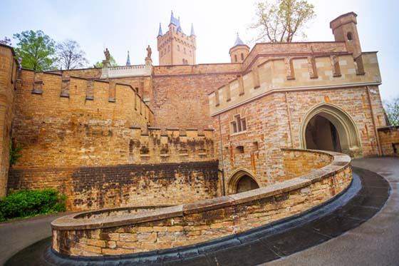 Entrance gates of beautiful Hohenzollern castle during summer day time in Germany